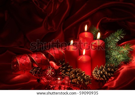 Christmas candles on a red background - stock photo