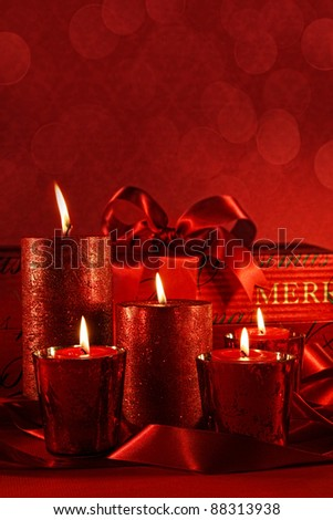 Christmas candles on a red vintage background - stock photo