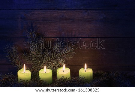 Christmas candles on wooden background - stock photo