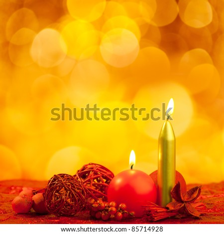 Christmas candles symbol with red dried leaves on golden background [Photo Illustration] - stock photo
