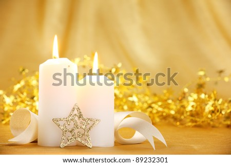 Christmas candles with festive decoration - stock photo