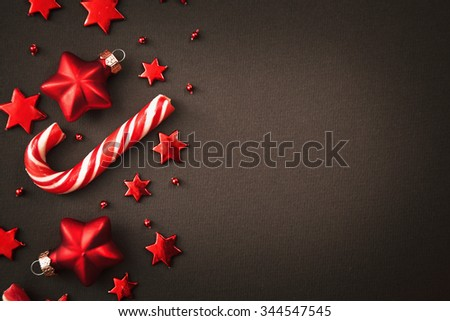 Christmas candy and decorations on dark background - stock photo