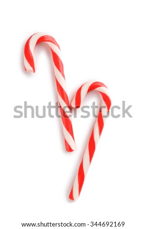 Christmas candy cane isolated on a white - stock photo