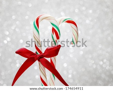 Christmas candy cane on silver background. Traditional american lollipop. - stock photo