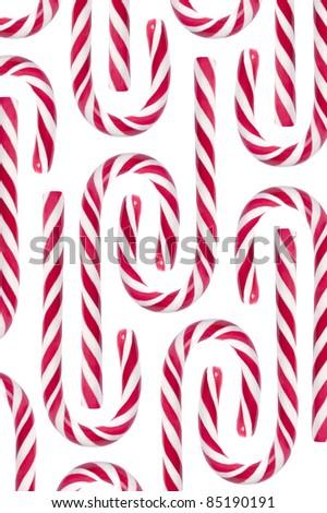 Christmas candy canes on white background - stock photo