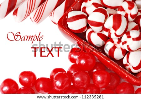 Christmas candy on white background with copy space. - stock photo