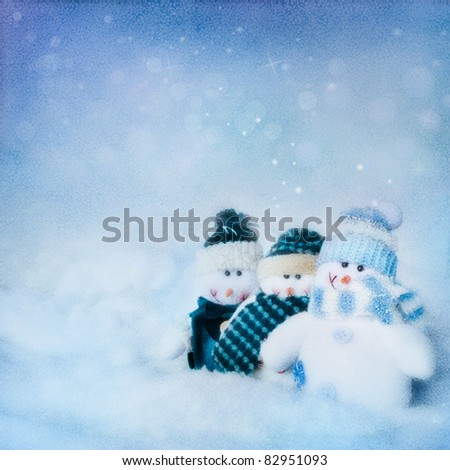Christmas card. abstract  textured background with three snowman in the night and beautiful winter background - stock photo