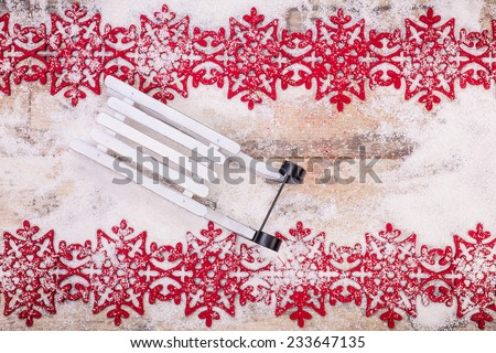 Christmas card. Christmas decoration over snow. Wooden background - stock photo