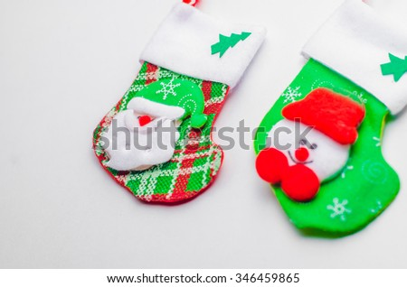 Christmas card,Christmas decoration, socks and toys on a rustic wooden background,horizontal photo