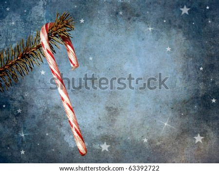 Christmas card featuring a candy cane hanging from a pine branch with whimsical designs and copy space. Grunge textured.