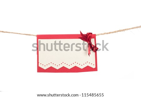 Christmas card hanging on a rope - stock photo