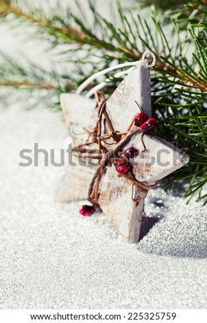 Christmas card idea with wooden star and branches of xmas tree - stock photo