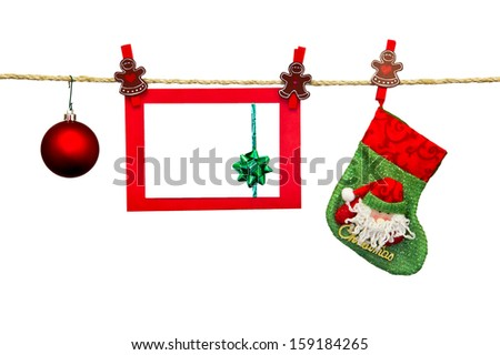 christmas card in clothesline isolated on white - stock photo