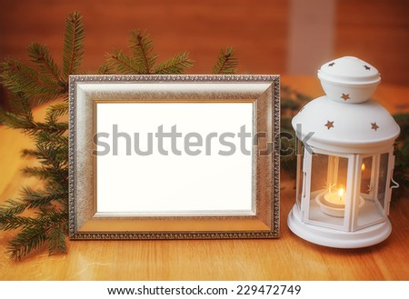 Christmas card invitation with a frame and candle holder, place for your text. - stock photo