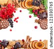 christmas card of cookies , berries , fruits , different xmas ingredients and spices on a white background - stock photo