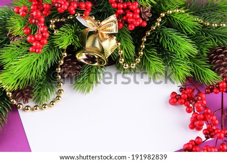 Christmas card on purple background - stock photo