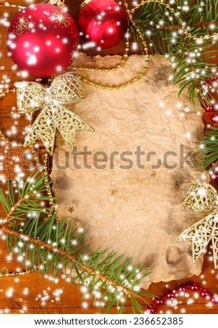 Christmas card on wooden table - stock photo