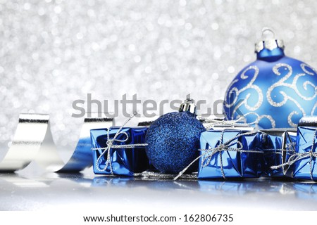 Christmas card with blue decoration on silver background - stock photo