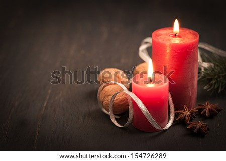 christmas card with candles and spices   - stock photo