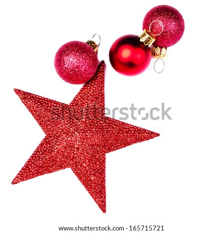 Christmas card with Christmas Decorations isolated on white backhround. Festive Red Star and red balls close up with copy space for greeting text. - stock photo