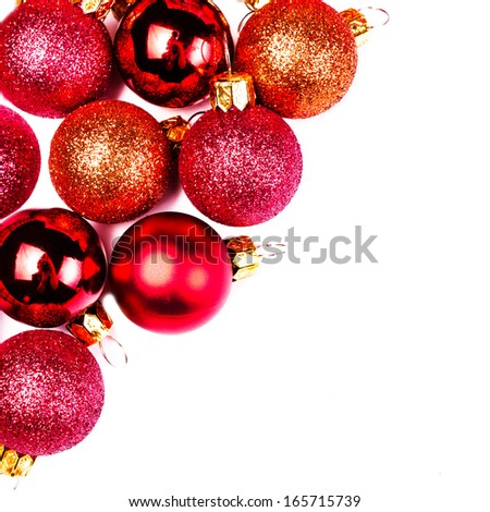Christmas card with Christmas Ornaments isolated on white backhrouns. Festive glittering red balls close up with copy space for greeting text. - stock photo