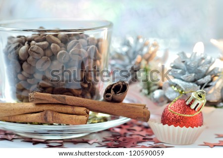 Christmas card with coffee beans and cinnamon close-up - stock photo