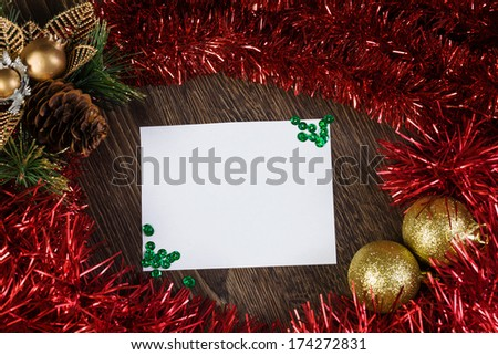 Christmas card with decoration balls and tinsel. Place for text