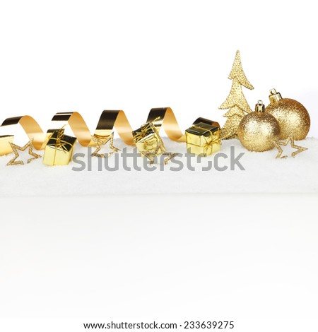 Christmas card with decorative golden baubles on snow - stock photo