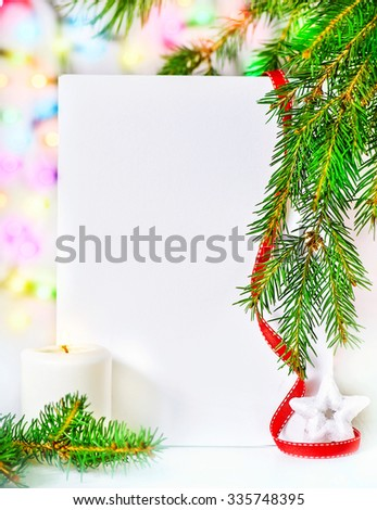 Christmas card with fir branch and candle on abstract bokeh background - stock photo
