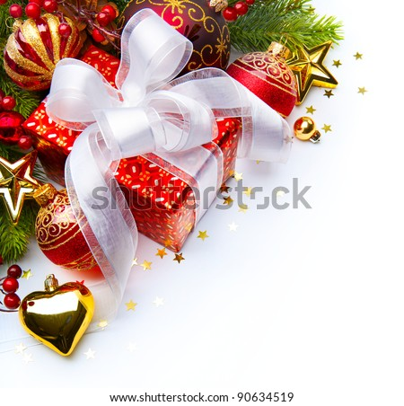 Christmas card with gift boxes and Christmas decorations on a white background - stock photo