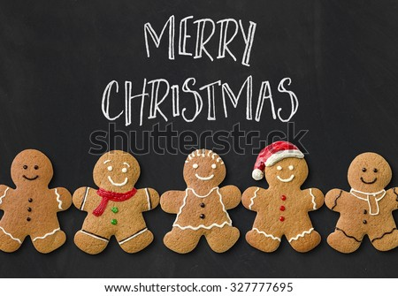 Christmas card with gingerbread men - stock photo
