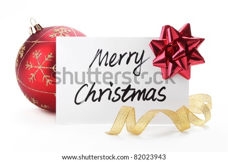 Christmas card with glossy ball and ribbon bow on white. - stock photo
