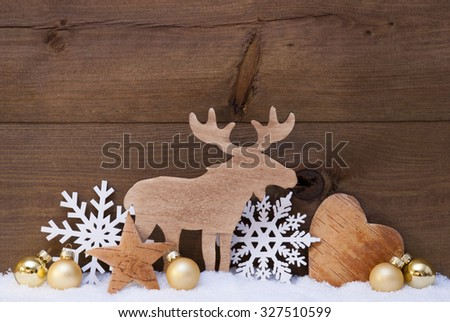 Christmas Card With Golden Festive Decoration On Snow. White Moose, Christmas Ball, Hear, Snowflake, Star. Brown, Rustic, Vintage Wooden Background. Copy Space For Advertisement