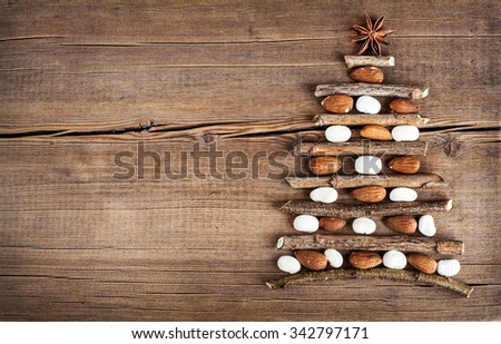 Christmas card with natural decorations on wooden background. Set of different varieties of objects in the form of a tree. Winter holidays concept - stock photo