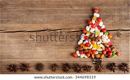 Christmas card with natural decorations on wooden background. Set of different varieties of objects in the form of a tree. Winter holidays concept. New year wallpaper - stock photo