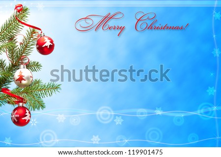 Christmas card with photo of decorated branch of fir tree on blue background. - stock photo