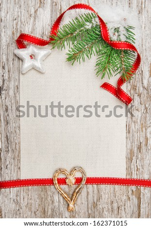 Christmas card with red ribbon, star and fir branch - stock photo