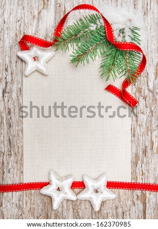 Christmas card with red ribbon, stars and fir branch  - stock photo