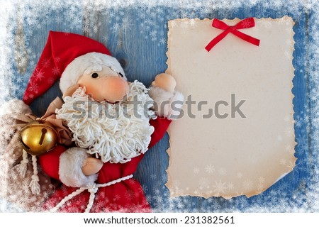 Christmas card with Santa Claus. Soft toy. Handwork - stock photo