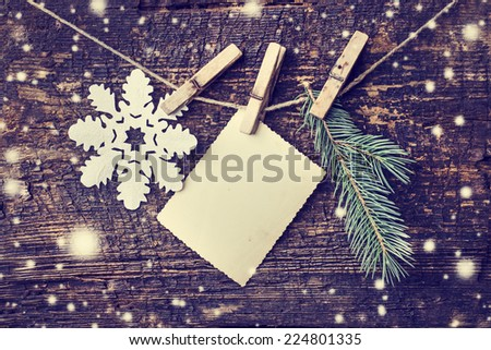 christmas card with snowflakes,fir  on wooden background/ Christmas card with christmas natural decorations - stock photo