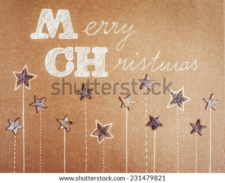 Christmas card with stars on cardboard background - stock photo