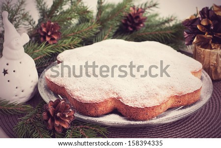 Christmas card with traditional fruitcake on plate and christmas decorations, retro style - stock photo
