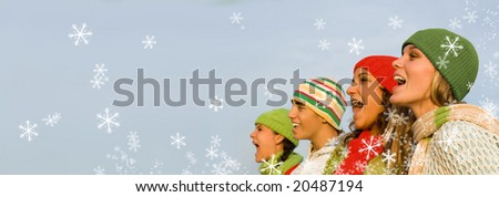 christmas carolers with falling snow - stock photo