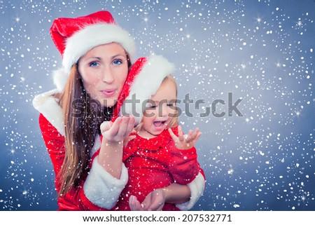 christmas celebrating family on blue background - stock photo