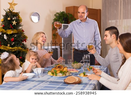 Christmas celebration in the bosom of happy smiling family at home