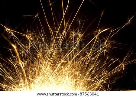 christmas celebration sparklers on black. See my portfolio for more - stock photo
