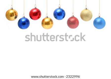 Christmas celebratory ornaments in the form of multi-coloured glass spheres above - stock photo