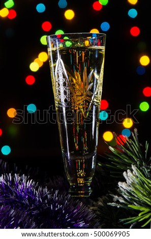 Christmas champagne on bokeh background