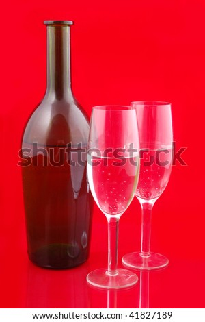 Christmas champagne on red background - stock photo