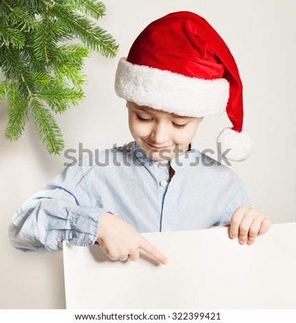 Christmas Child. Cute Small Boy and White Banner Background - stock photo